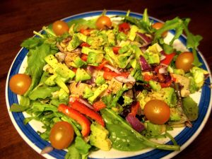 Mesclun, herbs, arugula, spinach adorned with avocado, tofu, red pepper, purple onions, and sungold cherry tomatoes. Now that's one big winter salad!